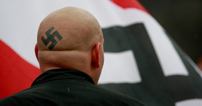 Nazis carrying Swastika flags interrupt Holocaust memorial event chanting 'six million more'